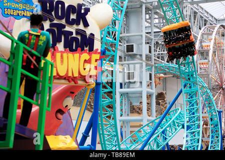 Visitors riding the roller coaster of Spongebob Squarepants