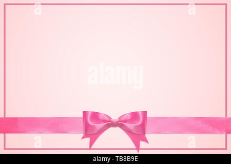 vintage greeting card template decorative with pink bow with horizontal ribbon isolated on white background - Stock Photo