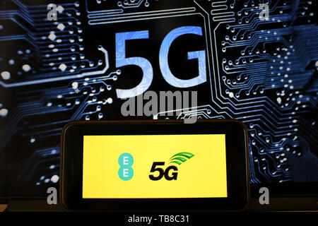 London, UK. 30th May, 2019. Photo taken on May 30, 2019 shows the logo of 5G network in London, Britain. Mobile network operator EE said on last Wednesday that it would launch Britain's first 5G service in six major cities on May 30th. Credit: Han Yan/Xinhua/Alamy Live News - Stock Photo