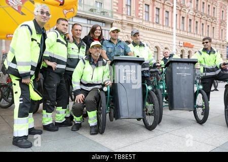 Zagreb, Croatia. 30th May, 2019. Participants pose for photos during the annual sanitation workers' garbage cart race at the central square in Zagreb, Croatia, May 30, 2019. Credit: Patrik Macek/Xinhua/Alamy Live News - Stock Photo