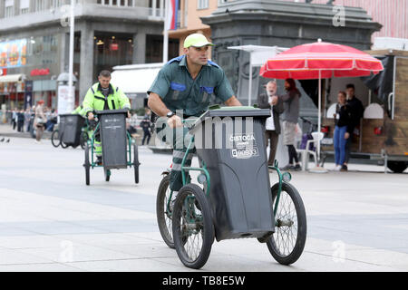 Zagreb, Croatia. 30th May, 2019. Participants compete during the annual sanitation workers' garbage cart race at the central square in Zagreb, Croatia, May 30, 2019. Credit: Patrik Macek/Xinhua/Alamy Live News - Stock Photo