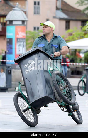 Zagreb, Croatia. 30th May, 2019. A participant competes during the annual sanitation workers' garbage cart race at the central square in Zagreb, Croatia, May 30, 2019. Credit: Patrik Macek/Xinhua/Alamy Live News - Stock Photo