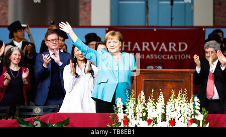 Cambridge, USA. 30th May, 2019. Chancellor Angela Merkel (CDU) waves to the audience after her speech at Harvard University. In an emotional speech at the US elite university Harvard, Chancellor Merkel promoted international cooperation and mutual respect - and clearly distinguished herself from US President Trump. Credit: Omar Rawlings/dpa/Alamy Live News - Stock Photo