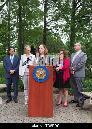 Hempstead, New York, USA. 30th May, 2019. At podium, U.S. Representative KATHLEEN RICE (NY-04) holds a press conference to announce she's introducing Three Bills to Congress to combat Impaired and distracted Driving. At left are STEVE CHASSMAN, Executive Director of Long Island Council on Alcoholism & Drug Dependence (LICADD); and Nassau County Executive LAURA CURRAN, and at right are ALISA MCMORRIS, whose son Andrew, a boy scout, was killed by a drunk driver exactly 8 months ago, and RICHARD MALLOW, Executive Director of MADD-New York. Congresswoman Rice announced the package of 3 b - Stock Photo