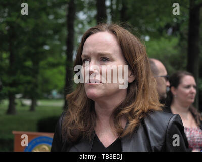 Hempstead, New York, USA. 30th May, 2019. U.S. Representative Kathleen Rice (NY-04) looks serious as she listens to people after her press conference to announce she's introducing Three Bills to Congress to Combat Impaired and Distracted Driving. Congresswoman Rice announced the package of 3 bills - End Drunk Driving Act, the Prevent Impaired Driving Child Endangerment Act, and the Distracted Driving Education Act of 2019 - at the Drunk Driving Victims Memorial in Eisenhower Park. Credit: Ann Parry/ZUMA Wire/Alamy Live News - Stock Photo