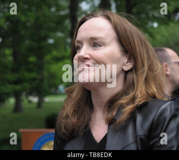 Hempstead, New York, USA. 30th May, 2019. U.S. Representative Kathleen Rice (NY-04) chats with people after her press conference to announce she's introducing Three Bills to Congress to Combat Impaired and Distracted Driving. Congresswoman Rice announced the package of 3 bills - End Drunk Driving Act, the Prevent Impaired Driving Child Endangerment Act, and the Distracted Driving Education Act of 2019 - at the Drunk Driving Victims Memorial in Eisenhower Park. Credit: Ann Parry/ZUMA Wire/Alamy Live News - Stock Photo