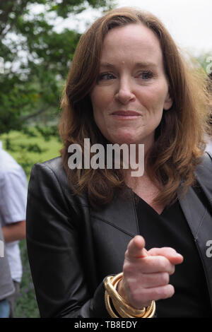 Hempstead, New York, USA. 30th May, 2019. U.S. Representative Kathleen Rice (NY-04) points her finger as she chats with people after her press conference to announce she's introducing Three Bills to Congress to Combat Impaired and Distracted Driving. Congresswoman Rice announced the package of 3 bills - End Drunk Driving Act, the Prevent Impaired Driving Child Endangerment Act, and the Distracted Driving Education Act of 2019 - at the Drunk Driving Victims Memorial in Eisenhower Park. Credit: Ann Parry/ZUMA Wire/Alamy Live News - Stock Photo