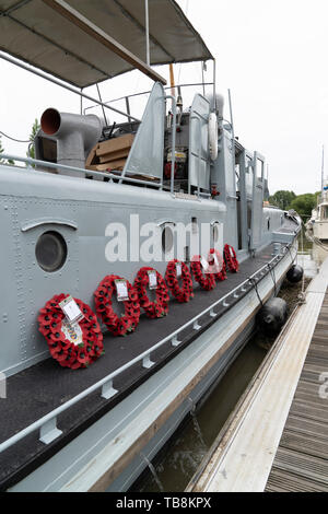 75th anniversary of D-Day. Six wreaths on the deck of P22, a former US built Rhine River Patrol Boat. Wraths displayed before been sailed to France. - Stock Photo