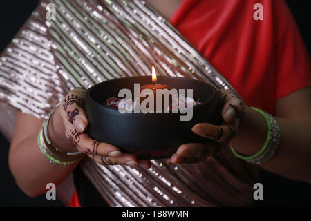 Beautiful woman with burning candle for celebration of Divaly, closeup - Stock Photo