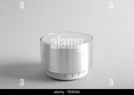 Smart home assistant device on light background - Stock Photo