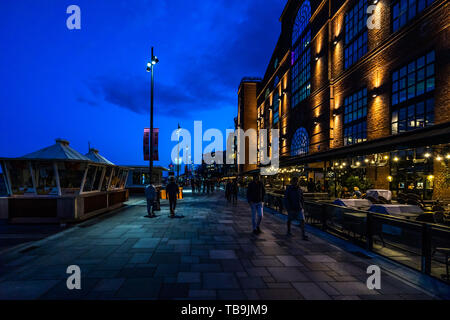 Night view of Aker Brygge waterfront promenade full of bar and restaurants, Oslo, Norway - Stock Photo