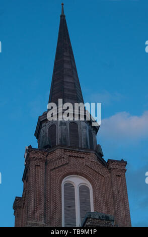 The sun sets on First United Methodist Church in downtown Columbus, Mississippi, April 20, 2010. - Stock Photo