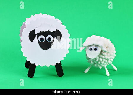 Diy Eid al adha lamb sheep cotton pads, cotton buds, swabs on green background. Gift idea, decor Eid al adha. Step by step. Top view. Process kid chil - Stock Photo
