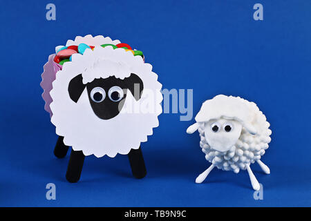 Diy Eid al adha lamb sheep cotton pads, cotton buds, swabs on blue background. Gift idea, decor Eid al adha. Step by step. Top view. Process kid child - Stock Photo