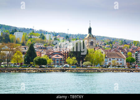 Shore of Lake Geneva in Evian-les-Bains city in France - Stock Photo