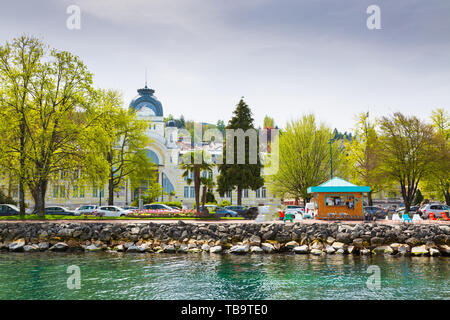 Shore of Lake Geneva in City of Evian-les-Bains in France - Stock Photo