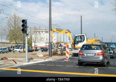 Kehl, Germany - Apr 4, 2017: Liebherr excavator working on roadworks installing new tramway rail in central German Kehl city - Stock Photo