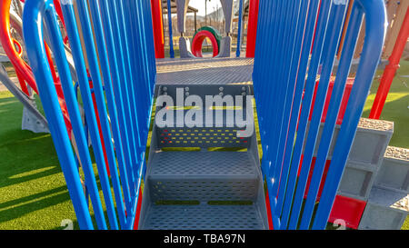 frame Panorama frame Stairs going up a slide overlooking mountain and bright sky on a sunny day - Stock Photo