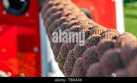 Panorama frame Close up of a brown rope illuminated by sunlight on a sunny day - Stock Photo