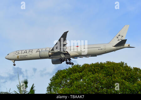 Singapore - Mar 27, 2019. 9V-SWI Singapore Airlines Boeing 777-300ER (Star Alliance livery) landing at Changi Airport (SIN). - Stock Photo