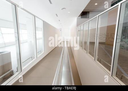 Modern office corridor with wheelchair pathway - Stock Photo