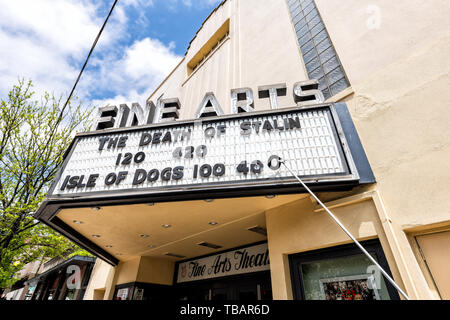 Asheville, USA - April 19, 2018: Downtown street in North Carolina NC city with entrance to building sign for Fine Arts Cinema movie Theatre with isle - Stock Photo