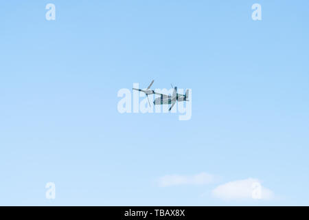 Destin, USA - April 24, 2018: Military US armed forces cargo airplane plane in blue sky with twin tail near Florida panhandle - Stock Photo