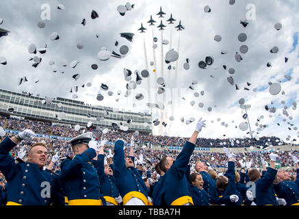 The U.S. Air Force Academy Class of 2019 graduates toss their hats skyward as the U.S. Air Force Thunderbirds roar overheadduring the graduation ceremony in Colorado Springs, Colo., May 30, 2019. Nine-hundred-eighty-nine cadets crossed the stage to become the Air Force's newest second lieutenants. (U.S. Air Force photo/Trevor Cokley) (released) - Stock Photo