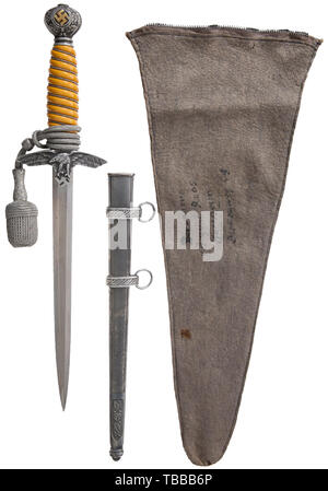 THE JOHN PEPERA COLLECTION, A M 1937 Dagger for Luftwaffe Officer, with Portepee, Maker SMF, Solingen. Plated blade with etched manufacturer's logo and stamped Waffenamt on reverse. Burnished aluminium crossguard, pommel with gilded swastikas and steel ferrule. Yellow-coloured celluloid grip with single aluminium wire wrap. Grey finish steel scabbard (minor aging). 23 cm silver/aluminium portepee and grey felt storage bag with zipper closure (faint ink name and address). Length 42.5 cm., Editorial-Use-Only - Stock Photo
