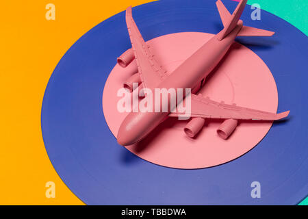 Flat lay of miniature toy airplane - Stock Photo