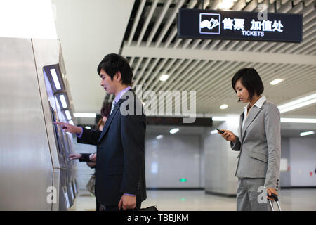 Business people take the subway on their commute to and from work. - Stock Photo