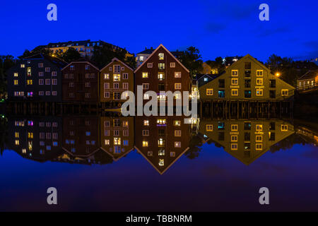 Traditional wooden stilt houses along River Nidelva. Trondheim, Norway, August 2018 - Stock Photo