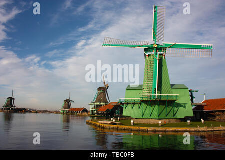 where to go and what to do in amsterdam, a tourist village with a view of the typical holland windmills built of wood - Stock Photo