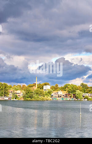 Old residential area at the Ziegelsee in Schwerin under dramatic clouds. Mecklenburg-Vorpommern, Germany - Stock Photo