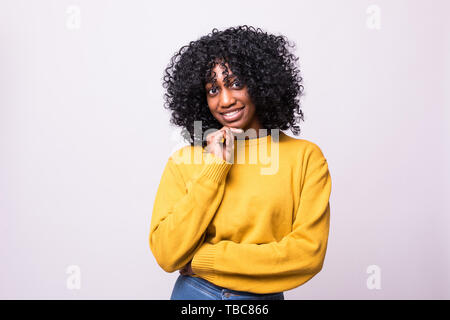 Portrait of beautiful young woman holding her chin, trying to find best solution. Body language - Stock Photo