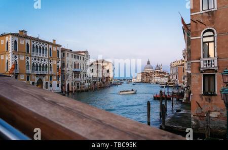Sunset view of Grand Canal with Basilica di Santa Maria della Salute from bridge, Venice, Italy. Stock Photo