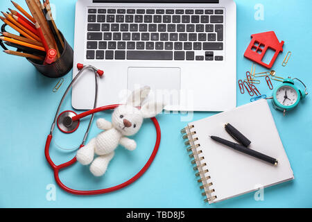 Workplace of pediatrician on color background - Stock Photo