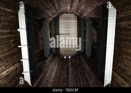 inside of a rusted metal grain silo - Stock Photo