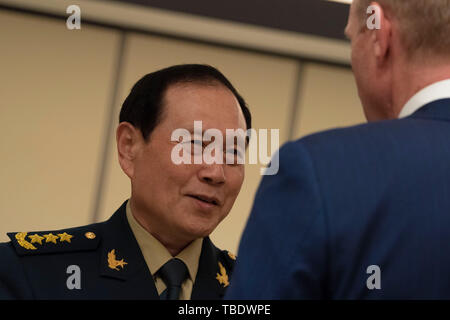 U.S. Acting Secretary of Defense Patrick Shanahan, right chats with Chinese Minister of Defense Wei Fenghe prior to a bilateral meeting at the IISS Shangri-La Dialogue 2019 May 31, 2019 in Singapore. - Stock Photo