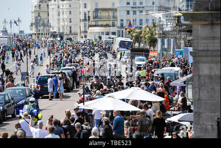 Brighton UK 1st June 2019 - Hundreds of Hells Angels arrive along Brighton's Madeira Drive on the seafront as part of their 50th anniversary celebration weekend . Over 3000 bikers from  rround the world have gathered in Surrey before heading down towards Brighton today where a heavy police presence was keeping an eye on them . Credit : Simon Dack / Alamy Live News - Stock Photo