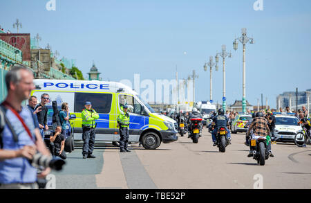 Brighton UK 1st June 2019 - Hundreds of Hells Angels arrive along Brighton seafront as part of their 50th anniversary celebration weekend . Over 3000 bikers from  rround the world have gathered in Surrey before heading down towards Brighton today where a heavy police presence was keeping an eye on them . Credit : Simon Dack / Alamy Live News - Stock Photo