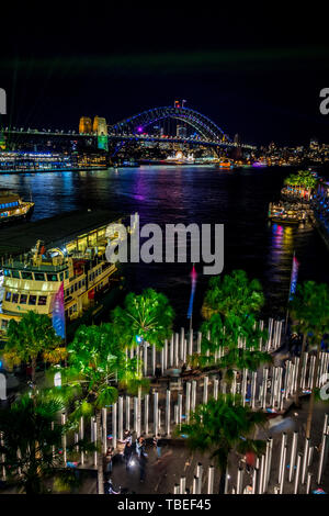 Sydney Harbour at night during the popular annual light festival, Vivid. - Stock Photo