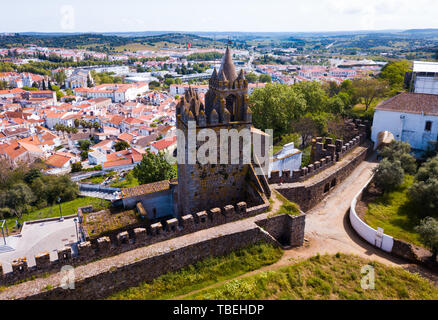 Aerial view of ruins of Montemor-o-Novo castle towering over settlement he once defended, Portugal - Stock Photo