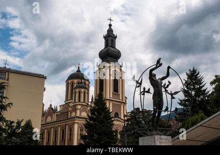 Sarajevo: Multicultural Man Builds the World by Francesco Perilli in Trg Oslobodenja (Liberation Square), Cathedral of the Nativity of the Theotokos - Stock Photo