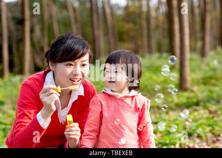 Daughter on outing with mother in park - Stock Photo