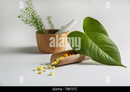 Scoop with plant based pills on light background - Stock Photo