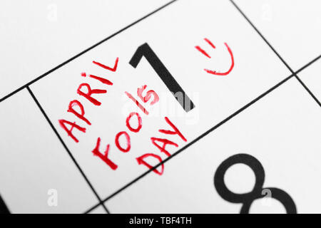 Calendar page of April with marked date of Fool's Day, closeup - Stock Photo