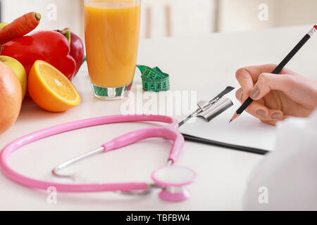 Female nutritionist working in her office - Stock Photo