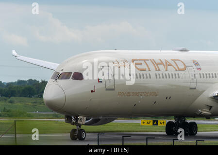 MANCHESTER UK, 30 MAY 2019: Etihad Boeing 787 Dreamliner flight EY21 from Abu Dhabi taxies at Manchaester Airport after landing - Stock Photo