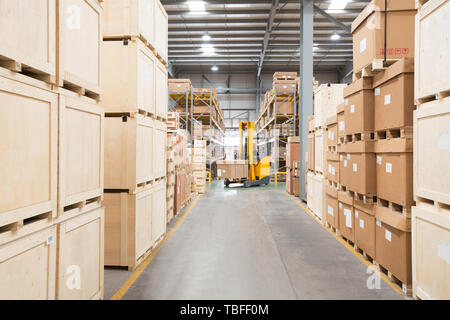 Logistics personnel load and unload cargo at the warehouse - Stock Photo